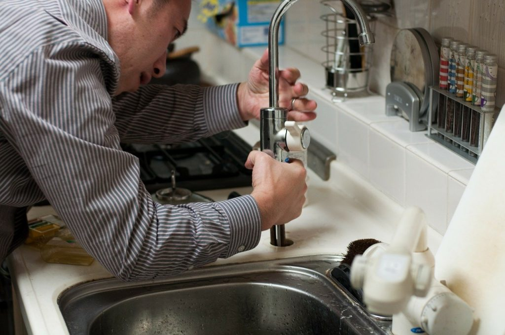 man doing plumbing